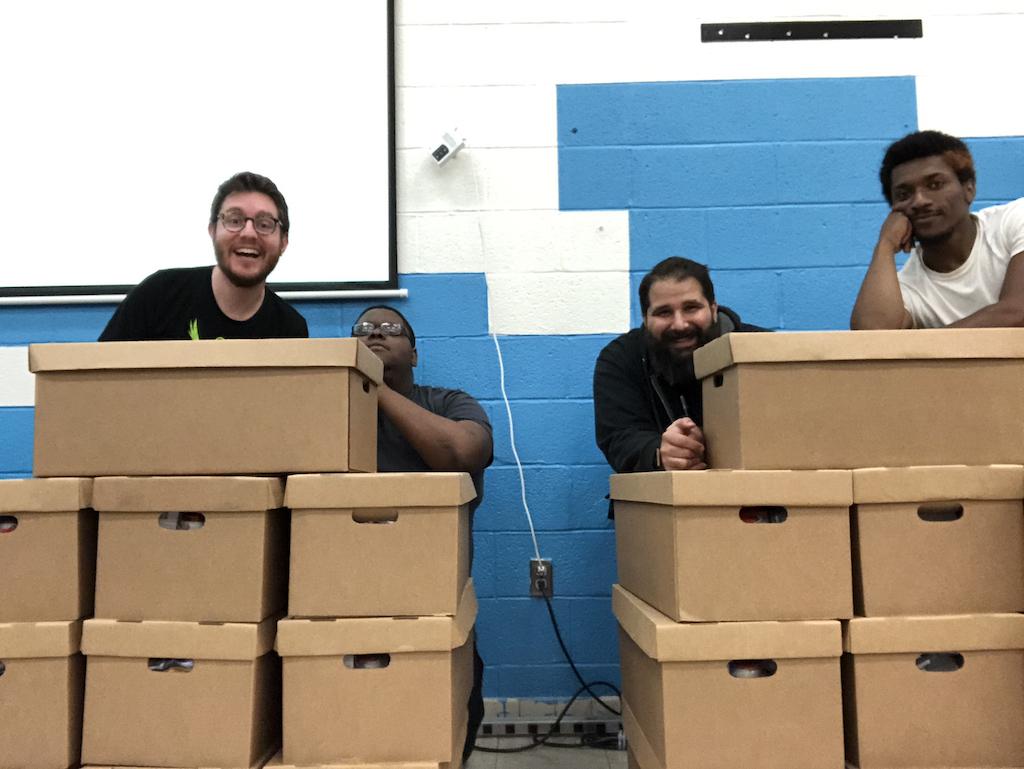 Photo of HWC Baltimore attendees behind cardboard