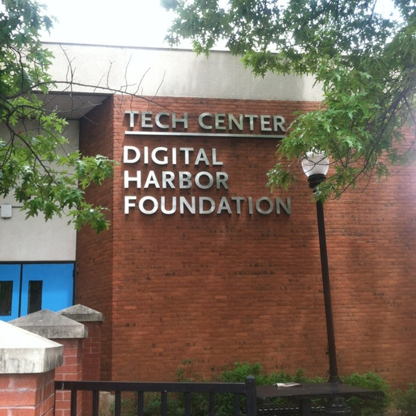 brick building exterior with chrome sign reading Digital Harbor Foundation Tech Center