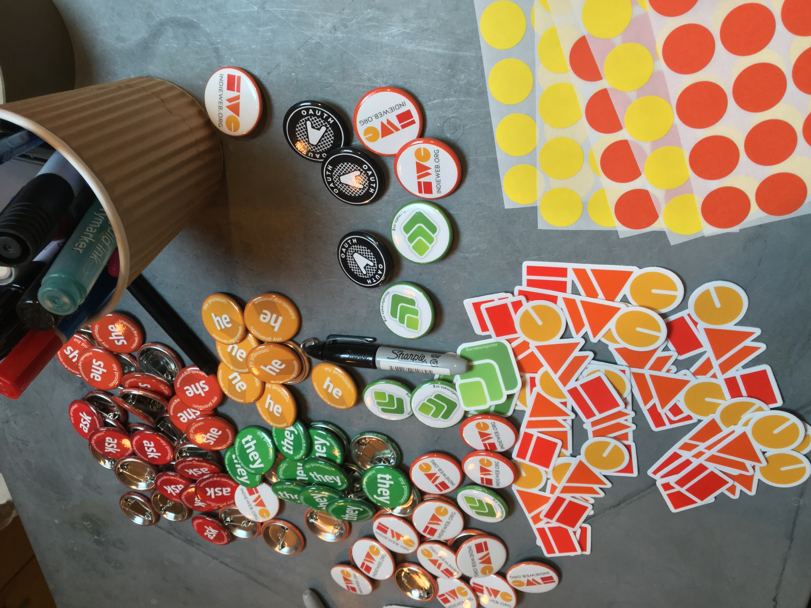 IndieWeb pins and stickers at IndieWebCamp Brighton registration