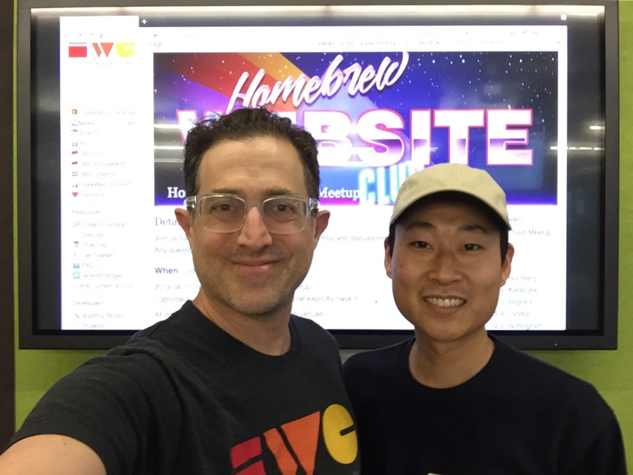 Tantek and Jeff standing in front of Homebrew Website Club event on a display at Mozilla San Francisco