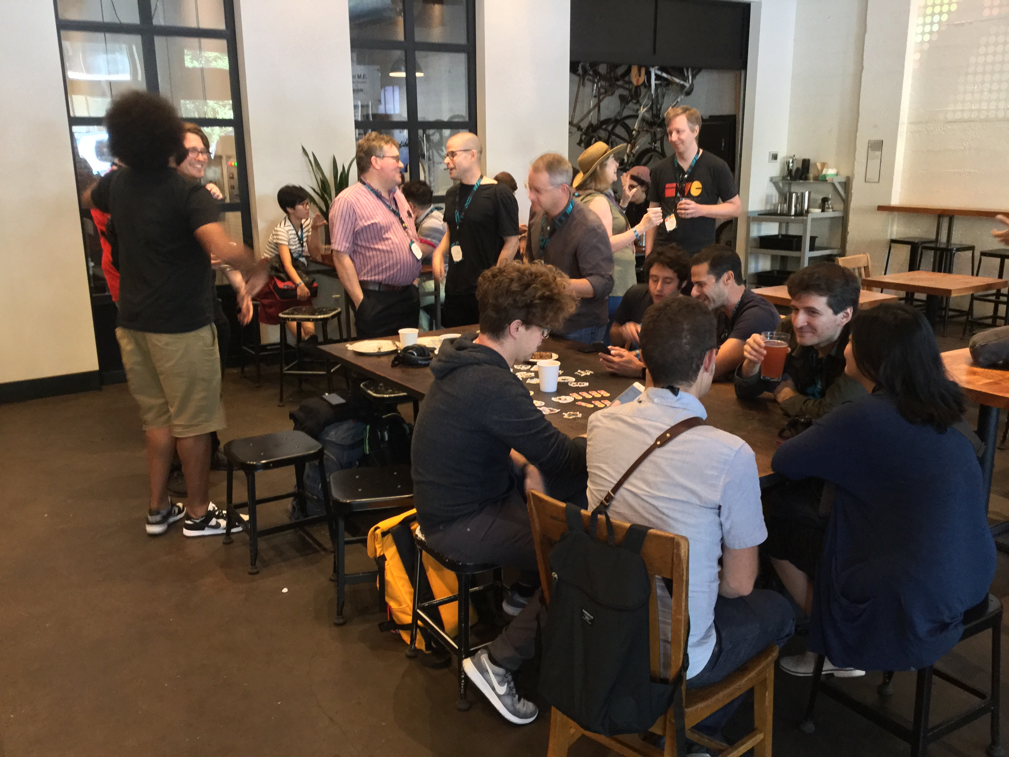 XOXO IndieWeb meetup participants taking over most of Cup and Bar