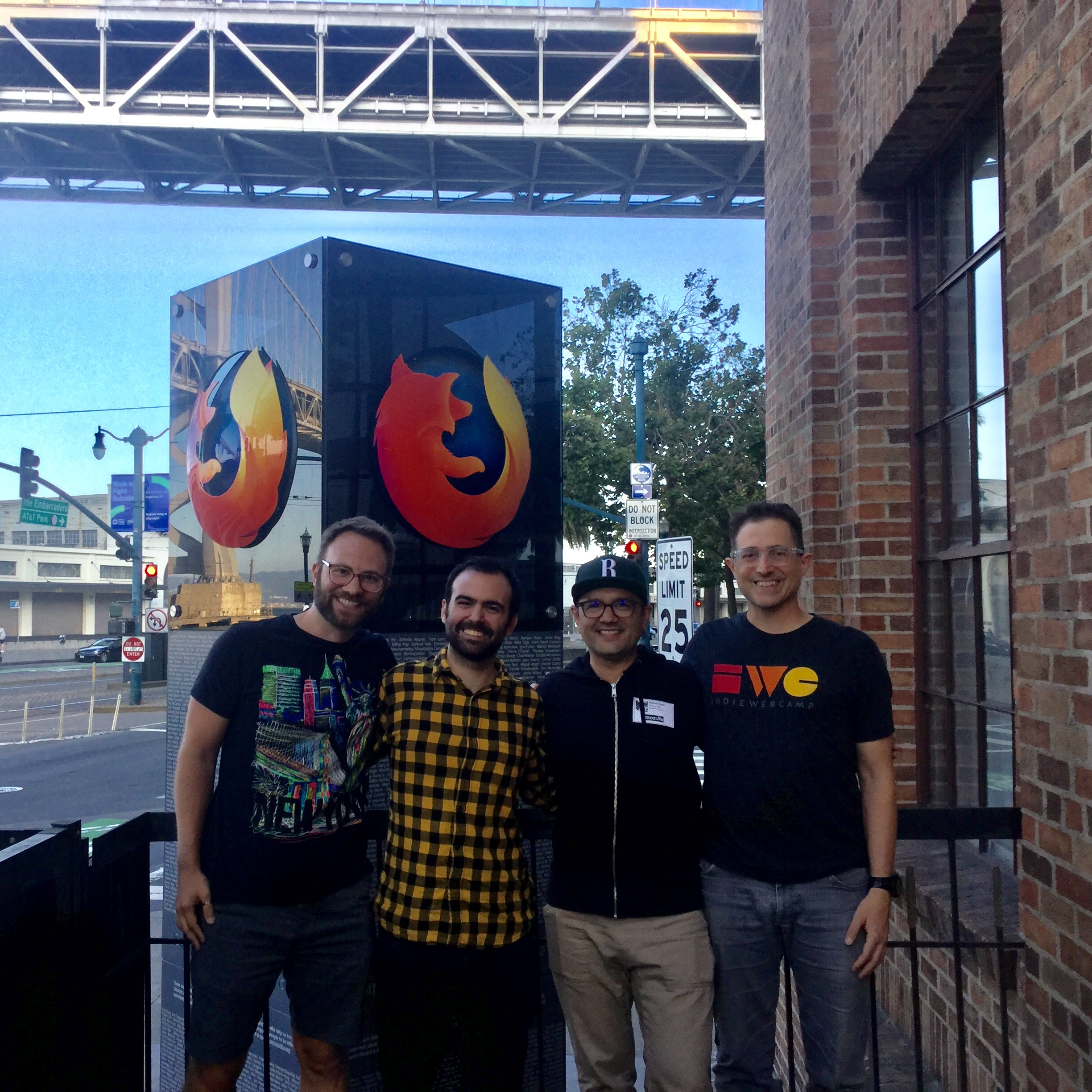 Dietrich, Tantek and a couple of other participants standing in front of the Firefox tower outside the Mozilla San Francisco Office