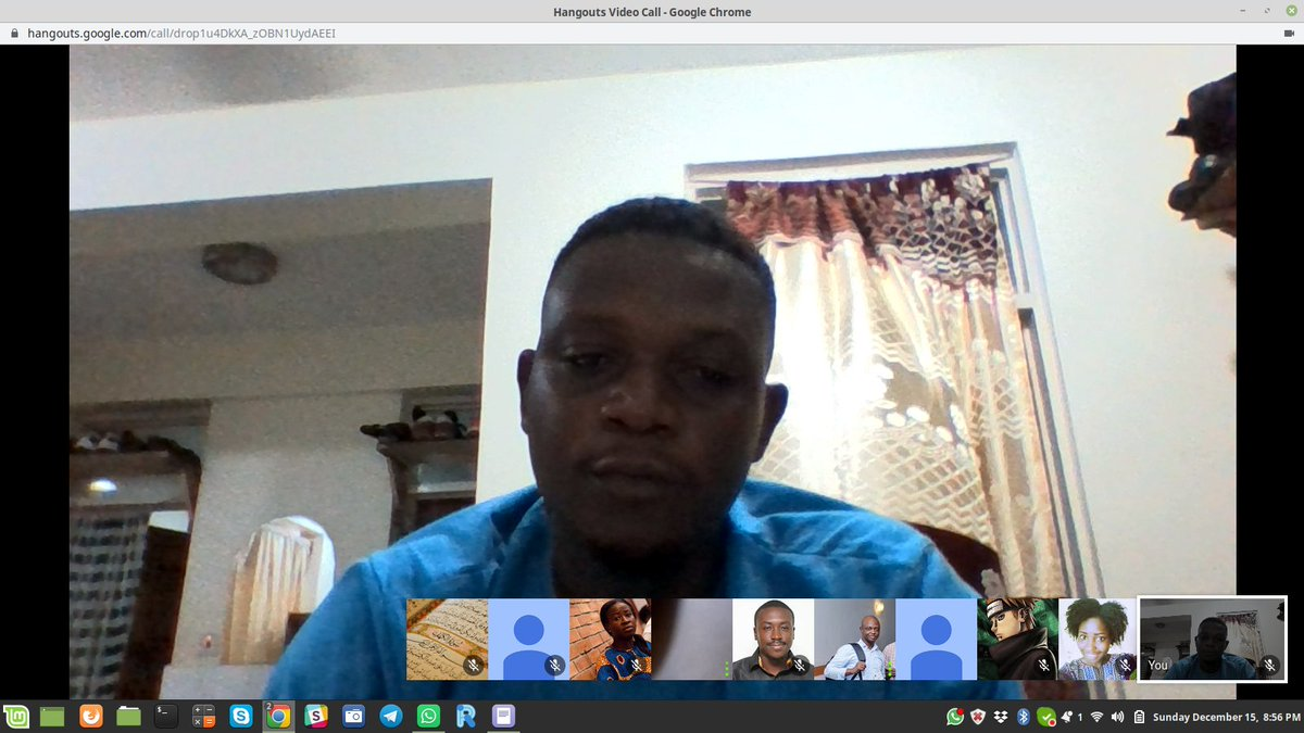 Screenshot of video confernece with Sadik in center frame and ten other participants