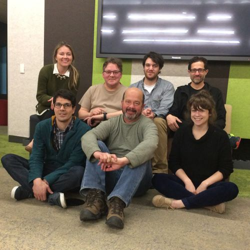 2015-02-25 Homebrew Website Club participants, seven of them, sit in two rows for a photograph